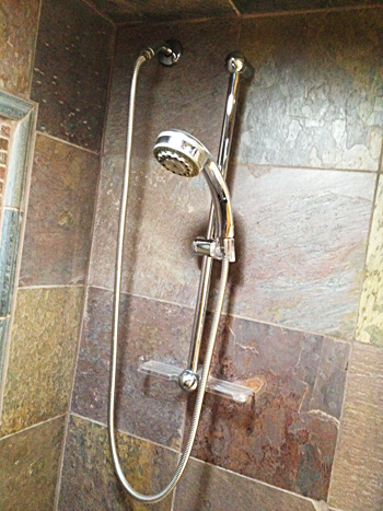 Shower wand installed by a plumber in Haltom City
